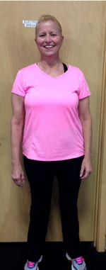 Trimmed down womain in bright pink shirt.
